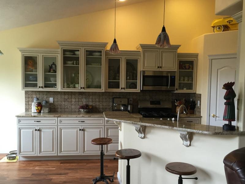 Kitchen remodel w/ white cabinetry & mocha glaze.