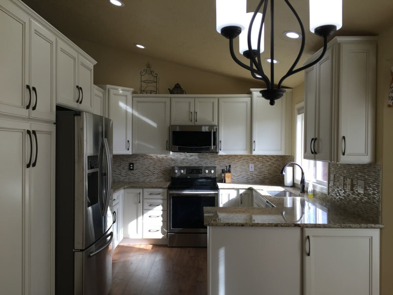 White kitchen w/ full height pantry in north Boise, Idaho